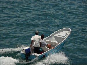 I ride a water taxi to Isla Carenero. Our nightime ride was on a similar dinky dingy.