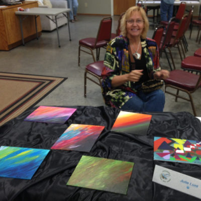 Julie with some of her RV-sized abstracts, Evergreen-Coho SKP Park