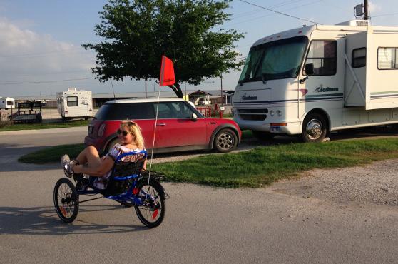 Julie rides her trike through Braunig Lake RV park, near San Antonio